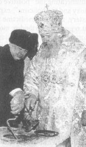 "Patriarch Alexy Ridiger and Prime Minister of the RF Victor Chernomyrdin laying the foundation-stone of the ""Savior over-garages"" church in Moscow. Soon afterwards the same high-ranking companion of the ""patriarch"" laid the foundation stone of the synagogue on the now defiled holy site in Moscow -- Poklonnaya gora."